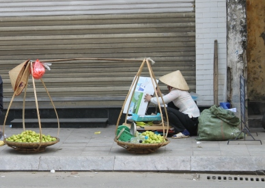 Most of the vendors on the streets of Hanoi are women like this one
