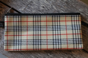 The fake Burberry pouch I bought to be my moldy Myanmese kyat wallet