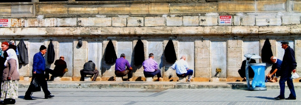 Ablutions before midday call to prayer